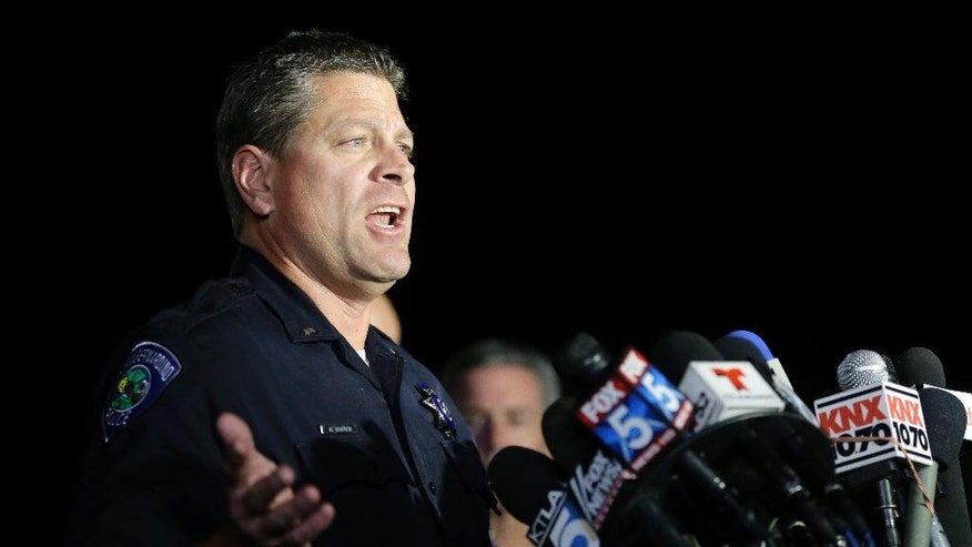 San Bernardino Police Lt. Mike Madden who was one one of the first officers on scene describes his experience during a press conference near the site of yesterday's mass shooting on Thursday, Dec. 3, 2015 in San Bernardino, Calif. A husband and wife on Wednesday, dressed for battle and carrying assault rifles and handguns, opened fire on a holiday banquet for his co-workers, killing at least 14 people and seriously wounding more than a dozen others in a precision assault, authorities said. Hours later, the couple died in a shootout with police. (AP Photo/Chris Carlson)
