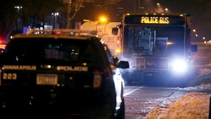 Dec. 3, 2015: Minneapolis Police make their way around the 4th Precinct after they cleared the protesters and their encampment in Minneapolis.