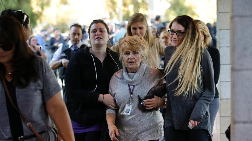 People who were near a deadly shooting at a social services center that killed multiple people arrive at at a community center in San Bernardino, Calif., Wednesday, Dec. 2, 2015. (AP Photo/Jae C. Hong)
