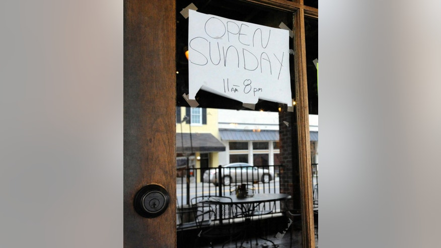 "This photo taken Tuesday, Nov. 17, 2015, shows the ""Open Sunday"" sign outside Marble City Grill in Sylacauga, Ala., where voters recently decided to legalize alcohol sales on Sunday. The change is part of a broad pattern across the South as churches lose their grip on a region where they could long set community standards. (AP Photo/Jay Reeves)"
