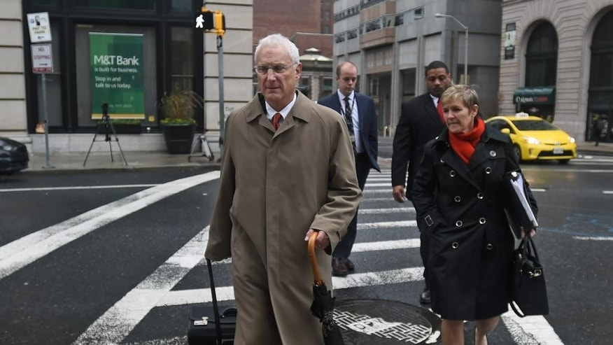 Michael Schatzow, Chief Deputy State's Attorney for Baltimore City, left, and his staff walk to courthouse East for the third day of jury selection for the trial of police officer William Porter, one of six Baltimore police officers charged with the death of Freddie Gray, on Wednesday, Dec. 2, 2015 in Baltimore.  Porter faces charges of involuntary manslaughter, second-degree assault, misconduct in office and reckless endangerment. The charges carry maximum prison terms totaling about 25 years. (Kevin Richardson/The Baltimore Sun via AP)  WASHINGTON EXAMINER OUT; MANDATORY CREDIT