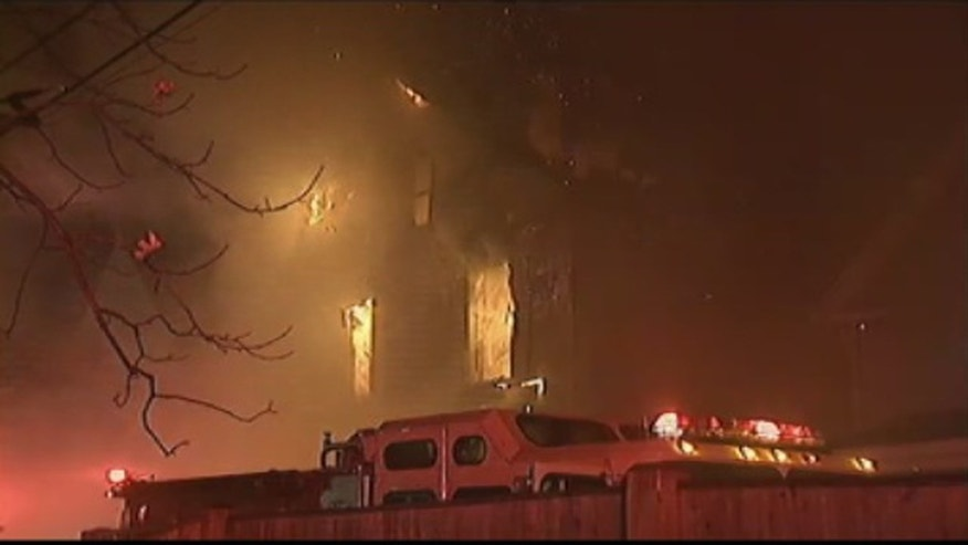 Flames tearing through the building in Lynn.