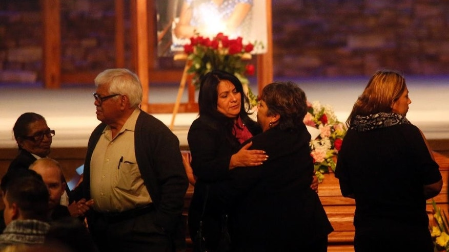 Beatriz Gonzalez, center, facing, mother of Nohemi Gonzalez, a victim of the Paris attacks, attends her daughter's funeral services at the Calvary Chapel in Downey, Calif., Friday, Dec. 4, 2015.  Gonzalez was the 23 year-old Cal State Long Beach student who was killed while dining with friends at a bistro in Paris last month.  (Genaro Molina/Los Angeles Times via AP, Pool)