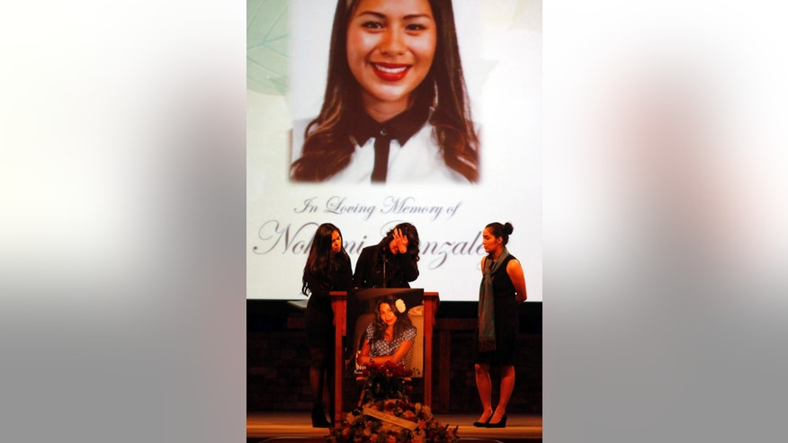 Cousins of Paris attack victim Nohemi Gonzalez share their memories and tears of their cousin at the Calvary Chapel in Downey, Calif., Friday, Dec. 4, 2015.  Gonzalez was the 23 year-old Cal State Long Beach student who was killed while dining with friends at a bistro in Paris last month.   (Genaro Molina/Los Angeles Times via AP, Pool)