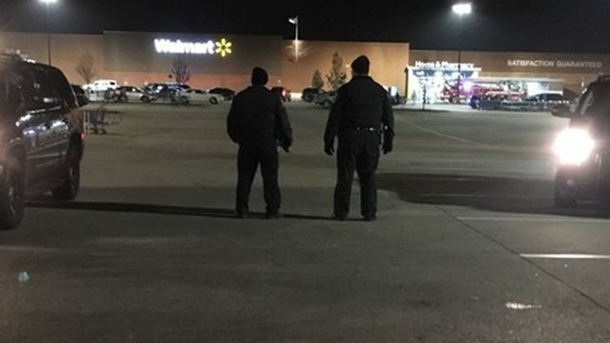 Dec. 3, 2015: Police patrol the parking lot of a Walmart in Darien, Ill. after a shooting left one person injured. (Fox 32 Chicago)