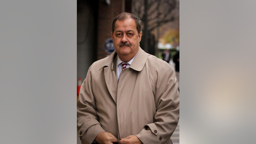 FILE -In this  Tuesday, Dec. 1, 2015, file photo, Former Massey Energy CEO Don Blankenship makes his way out of the Robert C. Byrd U.S. Courthouse during a break in deliberations, Charleston, W.Va.  Jurors have resumed deliberations in ex-Massey Energy CEO Don Blankenship's trial. Thursday, Dec. 3, 2015. Jurors have said twice they couldn't agree on a verdict. They have deliberated for all or part of nine days. Blankenship is charged with conspiring to break safety laws and defrauding mine regulators at West Virginia's Upper Big Branch Mine and lying to financial regulators and investors about safety. The coal mine exploded in 2010, killing 29 men. (AP Photo/Tyler Evert)