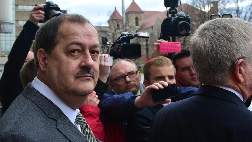 Don Blankenship leaves the federal courthouse with his attorneys after the verdict in his trial in Charleston, W.Va., Thursday, Dec. 3, 2015. The former Massey Energy CEO was convicted Thursday of a misdemeanor count connected to a deadly coal mine explosion and acquitted of more serious charges. (Tom Hindman/Charleston Gazette-Mail via AP) MANDATORY CREDIT