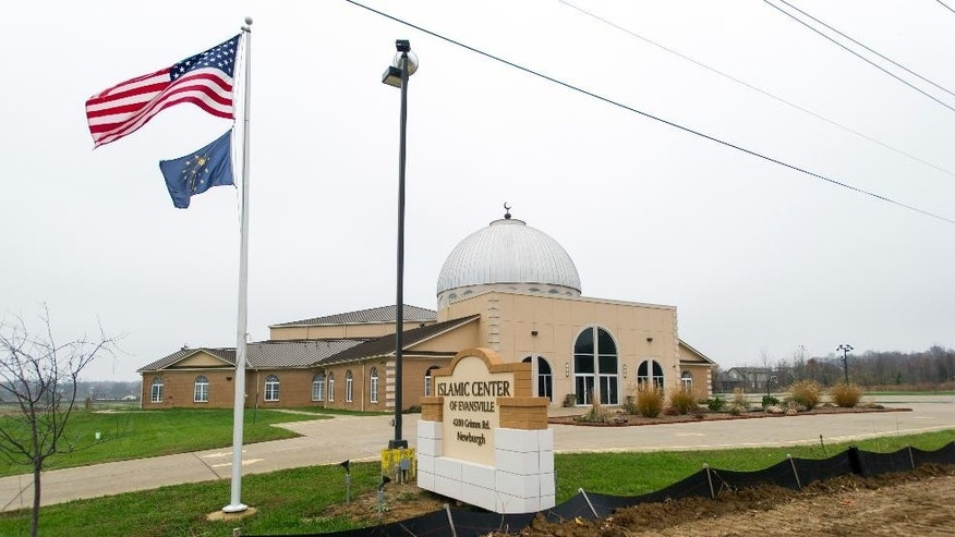 In this Nov. 30, 2015, photo, the American flag and the Indiana state flag fly in front of the Islamic Center of Evansville in Newburgh, Ind. Muslim families in this Ohio River town of about 3,300 near the Kentucky and Illinois border, many of whom have lived in the area for decades, say they've always felt accepted, even though anti-Islamic rhetoric has heated up across the nation after the Paris attacks in November. (AP Photo/Daniel R. Patmore)