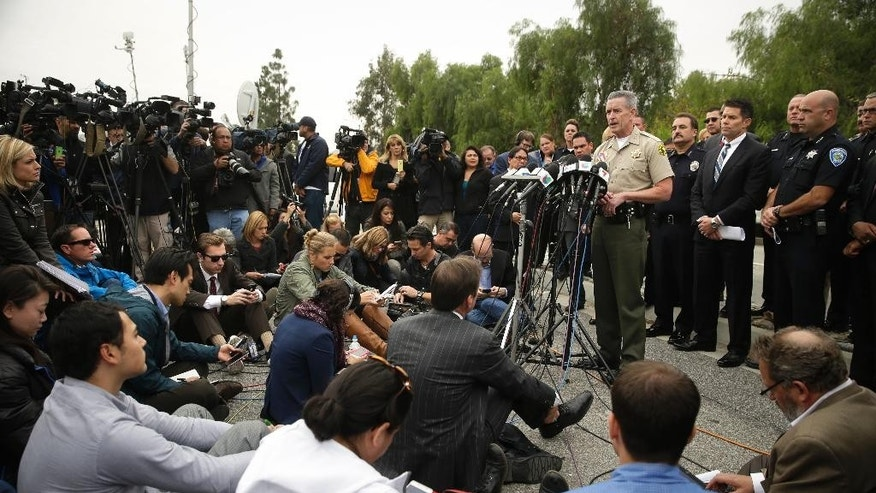 San Bernardino County Sheriff John McMahon talks to reporters during a news conference Friday, Dec. 4, 2015, in San Bernardino, Calif.  The FBI said Friday it is officially investigating the mass shooting in California as an act of terrorism, while a U.S. law enforcement official said the woman who carried out the attack with her husband had pledged allegiance to the Islamic State group and its leader on Facebook. (AP Photo/Jae C. Hong)
