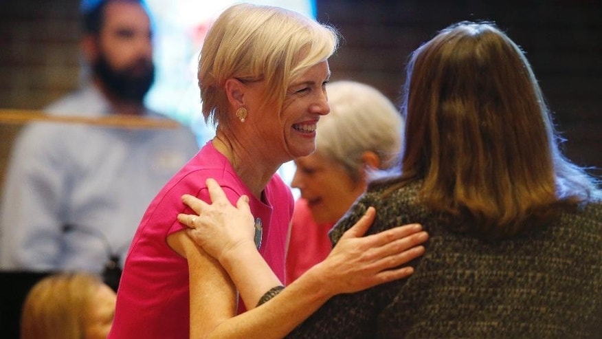 Cecile Richards, national head of Planned Parenthood, left, talks with U.S. Rep. Diana DeGette, D-Colo., after a rally in Englewood, Colo., on Saturday, Dec. 5, 2015. The event was organized as a response to the mass shooting at a Planned Parenthood clinic in Colorado Springs, Colo., a week ago in which three people died. (AP Photo/David Zalubowski)
