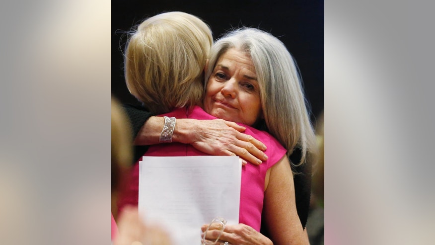 Vicki Cowert, right, executive director of Planned Parenthood of the Rocky Mountains, hugs Cecile Richards, national head of the organization, during a rally in Englewood, Colo., on Saturday, Dec. 5, 2015. The event was organized as a response to the mass shooting at a Planned Parenthood clinic in Colorado Springs, Colo., a week ago in which three people died. (AP Photo/David Zalubowski)