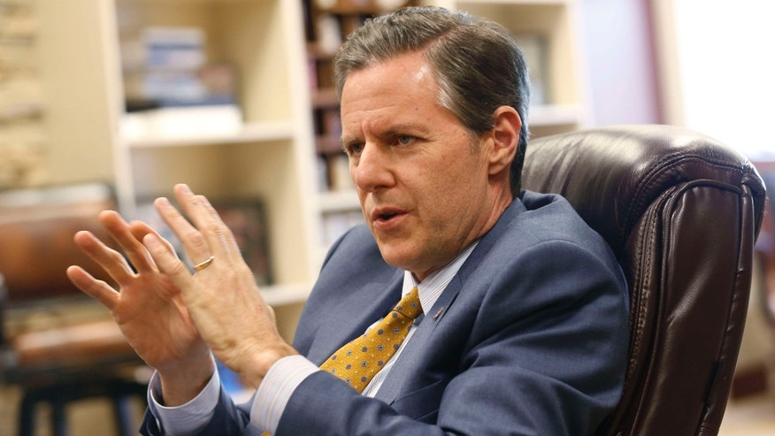 FILE - In this April 21, 2015, file photo, Liberty University president, Jerry Falwell Jr., gestures during an interview at the school in Lynchburg, Va.