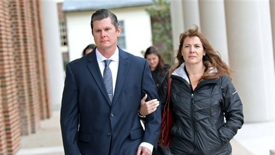 Thomas Webster walks into court with his wife.