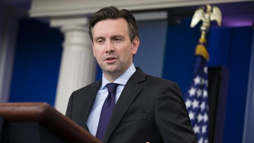 White House press secretary Josh Earnest answers a question about Republican Presidential candidate Donald Trump during the daily press briefing on Tuesday, Dec. 8, 2015, in Washington. (AP Photo/Evan Vucci)