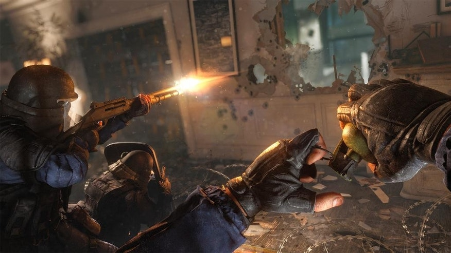 "In this photo provided by Ubisoft, a commando squad battles a terrorist cell in the video game, ""Tom Clancy's Rainbow Six Siege."" The world of online video games can be a nightmare, an every-man-for-himself, kill-or-be-killed wasteland that brings out our most nihilistic impulses. But big publishers are hoping to change that with more games that force us to work together _ particularly as they try to invent multiplayer competitions that will appeal to the ever-expanding audience for ""e-sports."" (Ubisoft via AP)"
