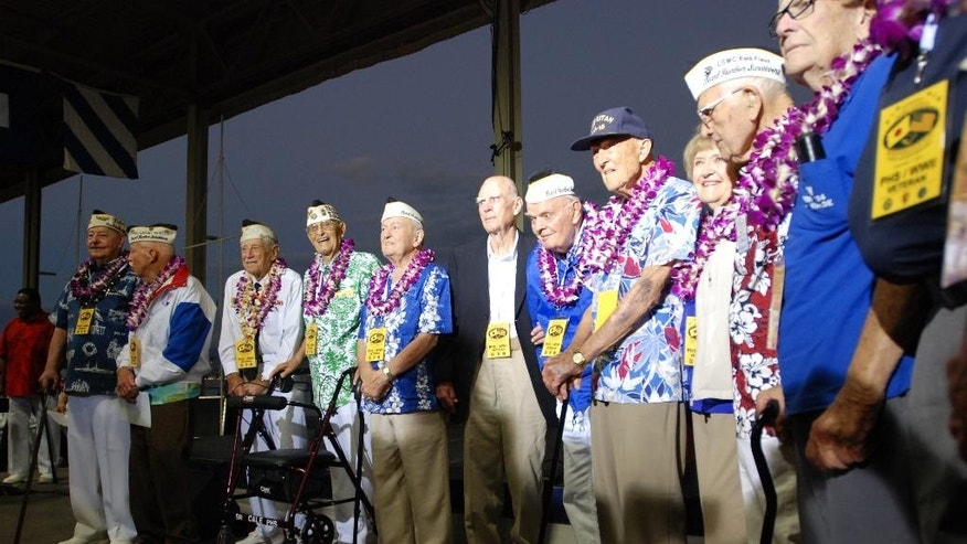 Pearl Harbor survivors gather on Monday, Dec. 7, 2015, in Pearl Harbor, Hi., before a ceremony marking the 74th anniversary of the Japanese attack that launched the U.S. into World War II. (AP Photo/Audrey McAvoy)