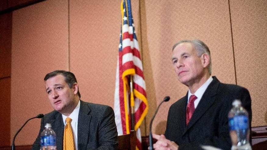 Republican presidential candidate Sen. Ted Cruz, R-Texas, left, and Texas Gov. Greg Abbott, right, speak about the resettlement of Syrian refugees in the U.S., during their joint news conference on Capitol Hill in Washington, Tuesday, Dec. 8, 2015. Abbott was in Washington with Cruz to support a bill Cruz has introduced in Congress banning any refugees from Iraq, Syria or other countries deemed to be controlled by a foreign terrorist organization.  (AP Photo/Pablo Martinez Monsivais)