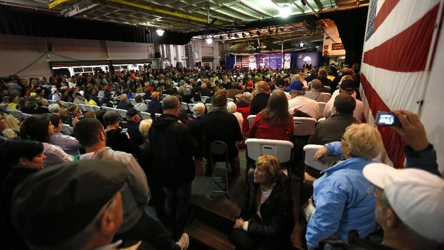 An overflow crowed fills the hangar deck of the USS Yorktown as Republican presidential candidate, businessman Donald Trump, speaks during a rally coinciding with Pearl Harbor Day at Patriots Point aboard the aircraft carrier USS Yorktown in Mt. Pleasant, S.C., Monday, Dec. 7, 2015. (AP Photo/Mic Smith)