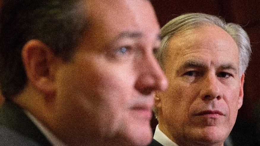 Texas Gov. Greg Abbott. right, listens to Republican presidential candidate Sen. Ted Cruz, R-Texas, left, speak about the resettlement of Syrian refugees in the U.S., during their joint news conference on Capitol Hill in Washington, Tuesday, Dec. 8, 2015.   Abbott was in Washington with Cruz to support a bill Cruz has introduced in Congress banning any refugees from Iraq, Syria or other countries deemed to be controlled by a foreign terrorist organization.  (AP Photo/Pablo Martinez Monsivais)