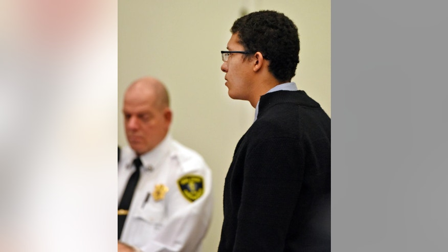 Philip Chism stands during his trial at Salem Superior Court, Wednesday, Dec. 9, 2015, in Salem, Mass. Chism is charged with rape and murder in the October 2013 slaying of 24-year-old Danvers High School teacher Colleen Ritzer. (Patrick Whittemore/The Boston Herald via AP, Pool)