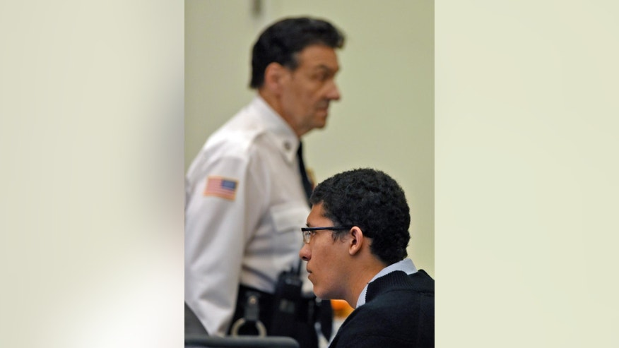 Philip Chism sits during his trial at Salem Superior Court, Wednesday, Dec. 9, 2015, in Salem, Mass. Chism is charged with rape and murder in the October 2013 slaying of 24-year-old Danvers High School teacher Colleen Ritzer. (Patrick Whittemore/The Boston Herald via AP, Pool)