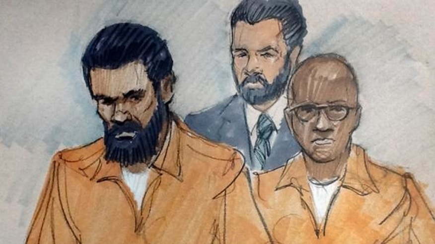 In this courtroom sketch, Jonas M. Edmonds, left, and Hasan R. Edmonds, right, stand in front of an FBI agent at a hearing in March.