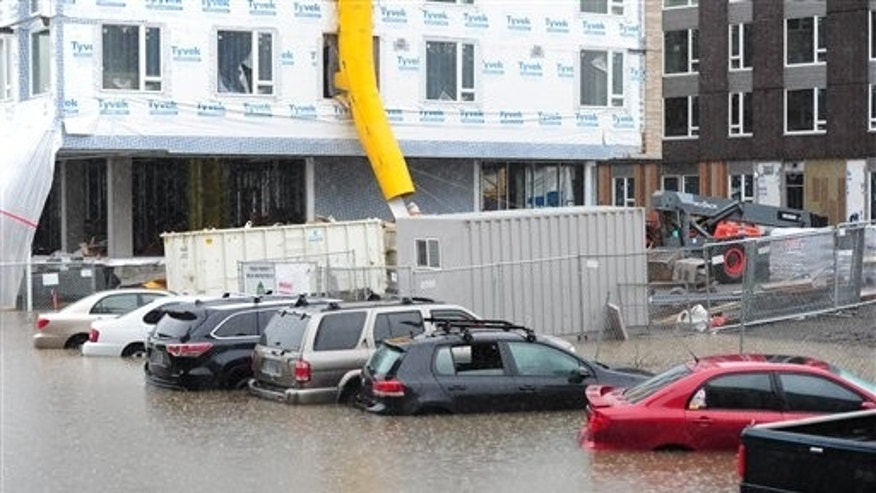 Floods trapping cars in Portland.