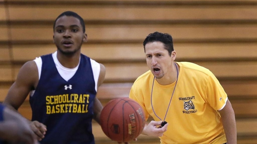 "In this Tuesday, Dec. 8, 2015 photo, Abe Mashhour, head basketball coach at Schoolcraft College, directs a practice session in Livonia, Mich. Mashhour came to the U.S. from Lebanon at the age of 4 - the youngest child of nine to escape that nation's civil war. His family moved to Dearborn, Mich., which has a large and longstanding Arab-American community. As a Muslim, he says, ""my faith is the center of who I am and what I was taught by my parents,"" and considers himself ""very blessed and fortunate to grow up in this country."" (AP Photo/Carlos Osorio)"
