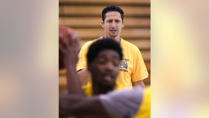 "In this Tuesday, Dec. 8, 2015 photo, Abe Mashhour, head basketball coach at Schoolcraft College, observes a practice session in Livonia, Mich. ""I like coaching a lot but I love working with people,"" said Mashhour, a husband and father of six who has coached for 20 years and also serves as athletic director in the Dearborn Public Schools. ""For me to help somebody in their life is a lot more significant ... than to win basketball games. I get a lot more joy out of that."" (AP Photo/Carlos Osorio)"