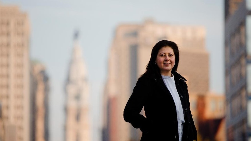 "Sally Baraka poses for a photo in Philadelphia on Wednesday, Dec. 9, 2015. As a Muslim and Arab-American, Baraka calls herself ""a devout Philadelphian"" who is an ambassador to her city, her country and her faith. (AP Photo/Matt Rourke)"