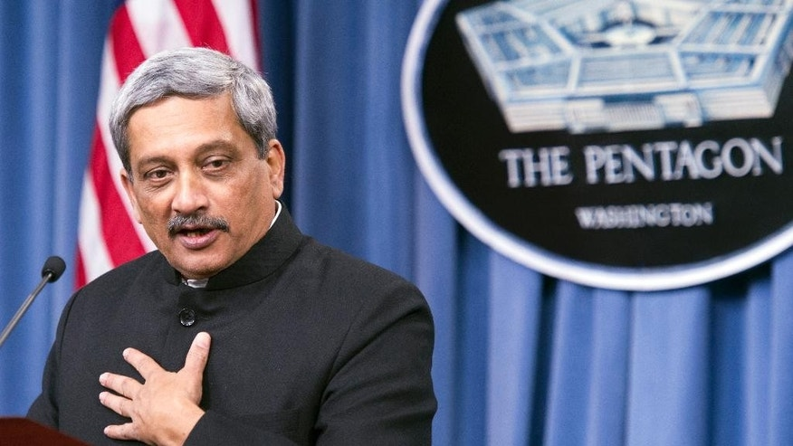 Indian Defense Minister Manohar Parrikar gestures while answering a reporters question during a joint news conference with Defense Secretary Ash Carter,  Thursday, Dec. 10, 2015, at the Pentagon. (AP Photo/Cliff Owen)