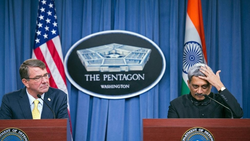 Indian Defense Minister Manohar Parrikar and Defense Secretary Ash Carter listen during their joint news conference, Thursday, Dec. 10, 2015, at the Pentagon. (AP Photo/Cliff Owen)