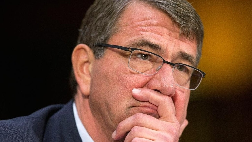 Defense Secretary Ash Carter testifies on Capitol Hill in Washington, Wednesday, Dec. 9, 2015, before the Senate Armed Service Committee. Carter said the U.S. is prepared to assist the Iraqi army with more personnel and equipment to help them fight Islamic State militants. (AP Photo/Pablo Martinez Monsivais)