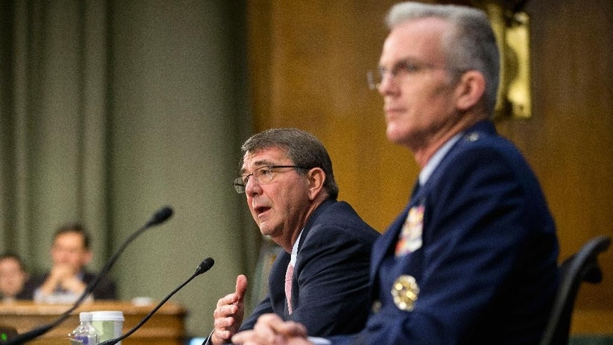 Defense Secretary Ash Carter, accompanied by Joints Chiefs Vice Chairman Gen. Paul Selva, testifies on Capitol Hill in Washington, Wednesday, Dec. 9, 2015, before the Senate Armed Service Committee. Carter said the U.S. is prepared to assist the Iraqi army with more personnel and equipment to help them fight Islamic State militants. (AP Photo/Pablo Martinez Monsivais)