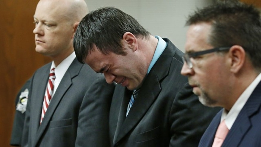 Dec. 10, 2015: Daniel Holtzclaw, center, cries as he stands in front of the judge after the verdicts were read in his trial in Oklahoma City. (AP Photo/Sue Ogrocki, Pool)