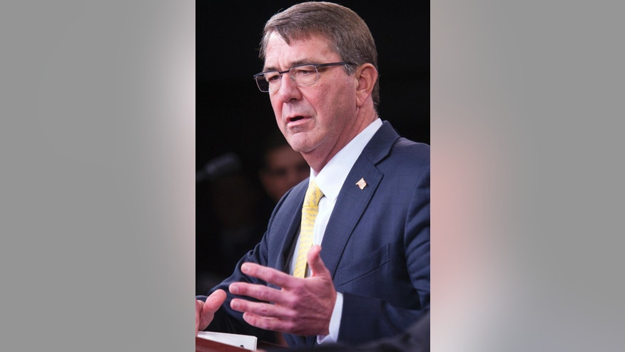 Defense Secretary Ash Carter answers a reporter's question during his joint news conference with Indian Defense Minister Manohar Parrikar, Thursday, Dec. 10, 2015, at the Pentagon. (AP Photo/Cliff Owen)