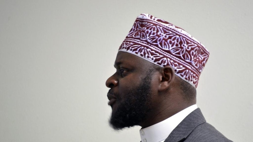 "Imam Shafi Abdul Aziz, of the the Islamic Center of New Mexico in Albuquerque, speaks to a group of advocates on Friday, Dec. 11, 2015. A coalition of Christian and Jewish leaders presented the Albuquerque mosque dozens of ""letters of support"" after GOP presidential hopeful Donald Trump suggested the U.S. place a moratorium on Muslim immigration. (AP Photo/Russell Contreras)"