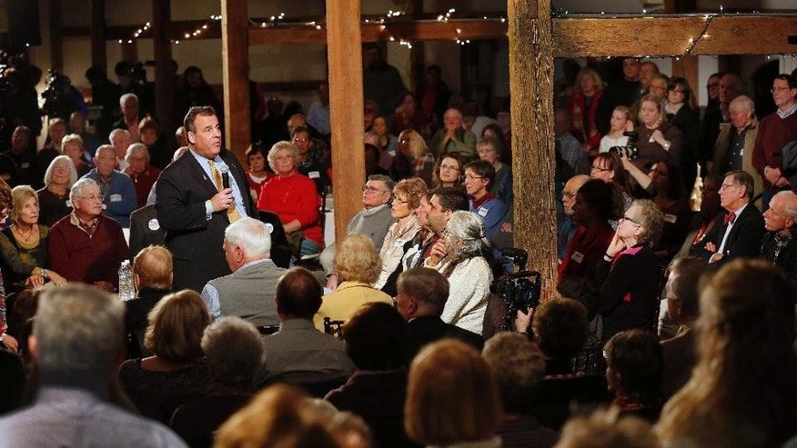 Republican presidential candidate New Jersey Gov. Chris Christie speaks to a packed barn during a campaign stop Friday, Dec. 11, 2015, in Wolfeboro, N.H. (AP Photo/Jim Cole)