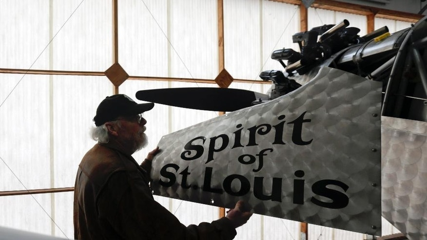 In this Sunday, Dec. 6, 2015 photo, pilot Ken Cassens readies a Spirit of St. Louis replica for flight at the Old Rhinebeck Aerodrome in Rhinebeck, N.Y. Cassens has spent years creating a doppelganger of the plane Charles Lindbergh flew across the Atlantic in 1927 down to every flap and fuel gauge. (AP Photo/Mike Groll)