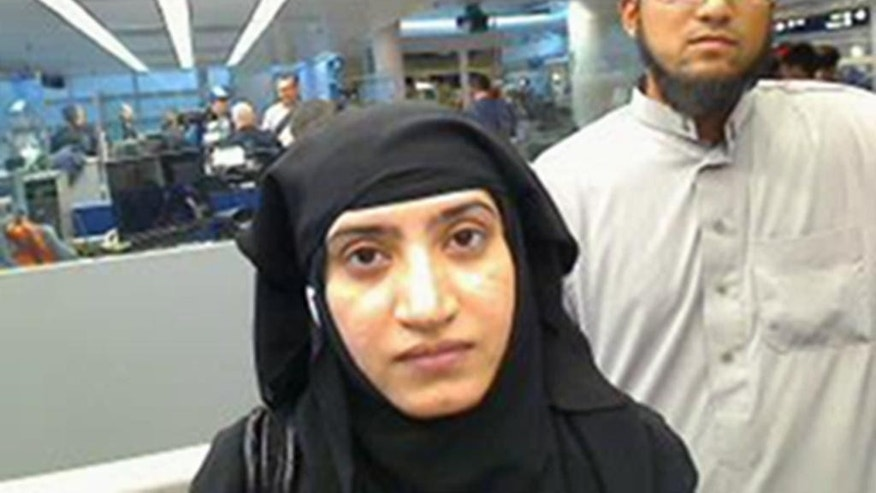 FILE - This July 27, 2014 file photo provided by U.S. Customs and Border Protection shows Tashfeen Malik, left, and Syed Farook, as they passed through O'Hare International Airport in Chicago. The husband and wife died on Dec. 2, 2015, in a gun battle with authorities several hours after their assault on a gathering of Farook's colleagues in San Bernardino, Calif. (U.S. Customs and Border Protection via AP, File)