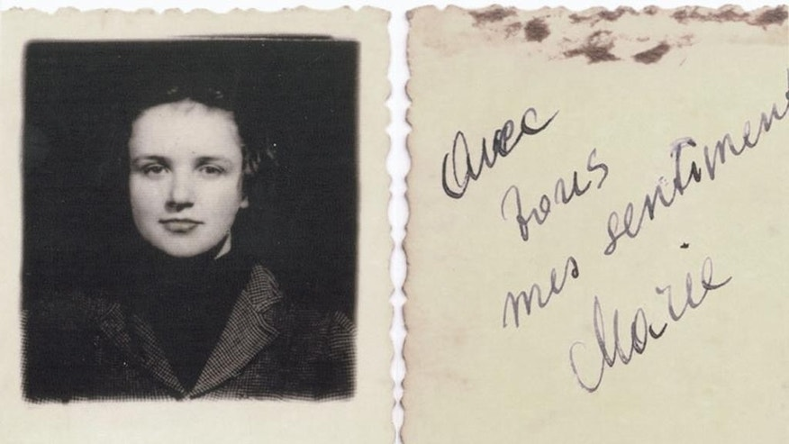 "This undated picture provided by Akira Kitade from an album owned by Tatsuo Osako, a former colleague of Kitade's at the Japan Tourist Bureau, shows a woman and an accompanying message on the back signed by Marie, reading ""avec tous mes sentiments"" in French, or ""with all my affections.""  Osako's album contained seven photos given to him by people he helped to escape from Europe in the early days of World War II. Five of them have been identified, but a former employee of Osako, who died in 2003, is still trying to identify the woman in this photo. (Akira Kitade via AP)"