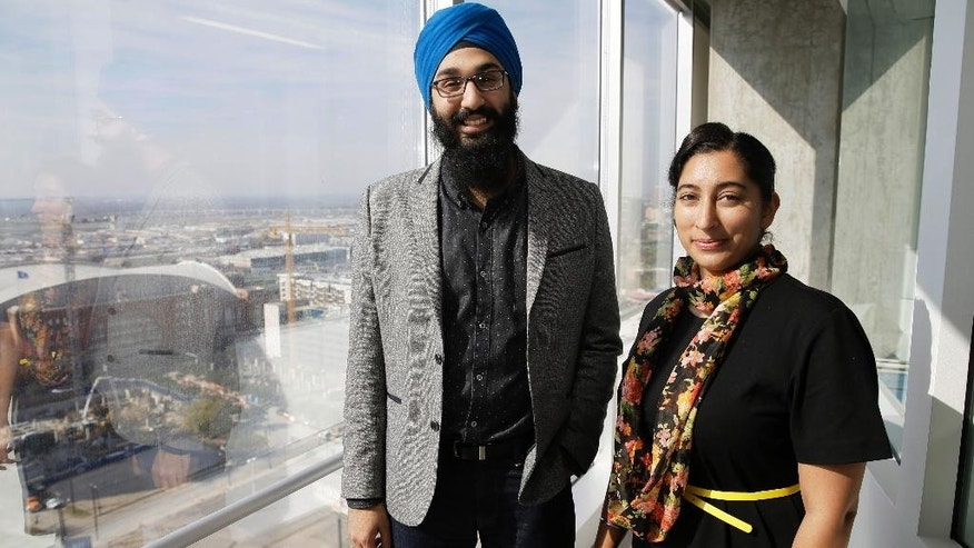 In this Dec. 11, 2015, photo, Darsh Singh, left, poses for a photo with his wife, Lakhpreet Kaur, in Dallas. It happens regularly: Someone sees a man with a turban and beard and hurls anti-Muslim slurs his way, or worse. Members of the Sikh religion, like Singh and his wife, also are feeling vulnerable as anti-Islamic sentiment heats up across the U.S., but instead of distancing themselves from Muslims, members of this southeast Asian religion are working with them to combat hateful rhetoric and dispel misconceptions about their respective faiths. (AP Photo/LM Otero)