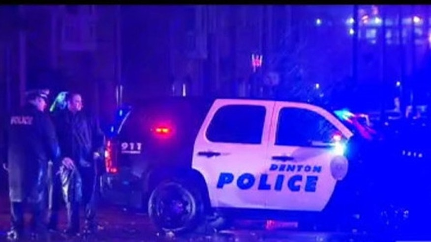 Dec. 13, 2015: Police respond to a shooting involving a University of North Texas police officer and a student in Denton, Texas. (KDFW)
