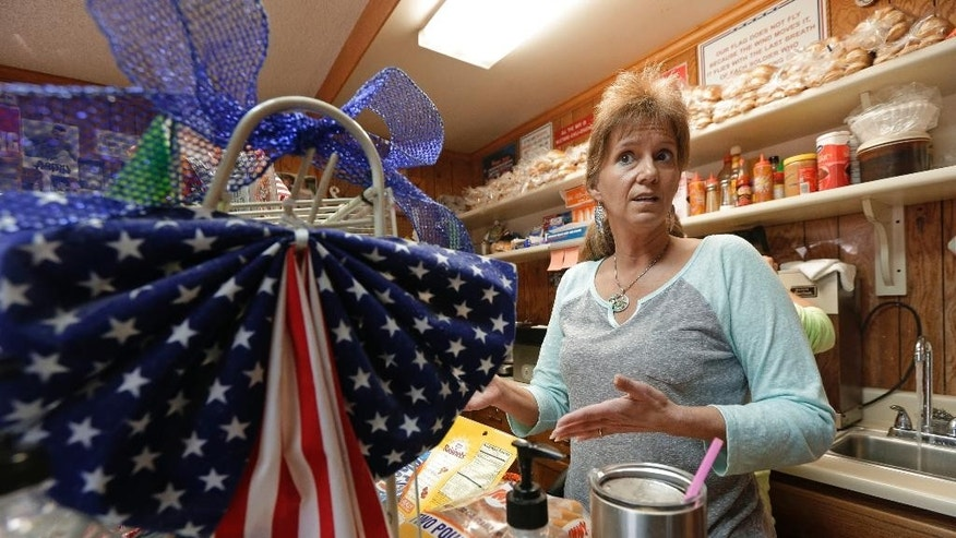 """Tracy Hooker talks about Republican presidential candidate Donald Trump at Rosie's Hot Dogs in Greer, S.C., Thursday, Dec. 10, 2015. Trump's supporters don't see his plan to ban Muslims from entering the U.S. as """"xenophobic"""" or an """"appeal to hate,"""" but rather as an entirely reasonable response to a clear and present threat. (AP Photo/Chuck Burton)"""