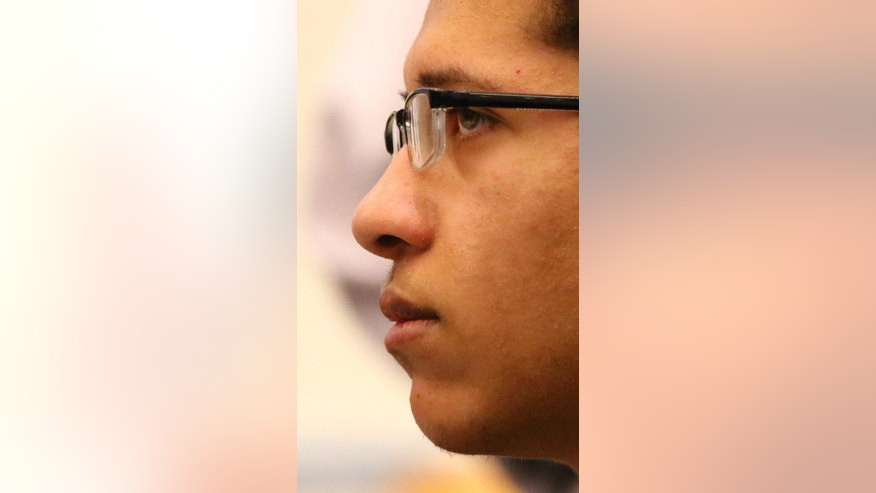 """Philip Chism watches jurors during closing arguments of his murder trial in Salem Superior Court, Monday, Dec. 14,2015, during closing arguments. The Massachusetts teenager who raped and killed his high school math teacher """"knew right from wrong and could choose right from wrong,"""" a prosecutor said Monday during closing arguments in the teen's murder trial. (Mark Lorenz/The Boston Herald via AP, Pool)"""