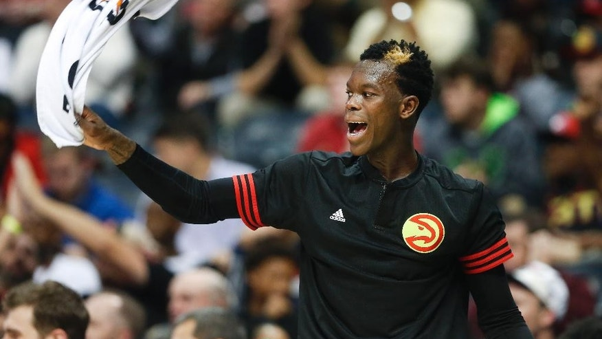 "FILE - In this Nov. 11, 2015, file photo, Atlanta Hawks guard Dennis Schroder (17) reacts after an Atlanta basket late in the second half of an NBA basketball game against the New Orleans Pelicans, in Atlanta. Muslim athletes have responded over the past week after Donald Trump proposed a ban on Muslims entering the U.S. Schroder, who was born in Germany, says he hasn't noticed any hostility from the average fan about his faith.""I never hear nothing bad in Germany or here,"" he said. ""I think a lot of people know that ISIS is not the same as Muslim people and that's the reason I have no problems with fans or anybody."" (AP Photo/John Bazemore, File)"