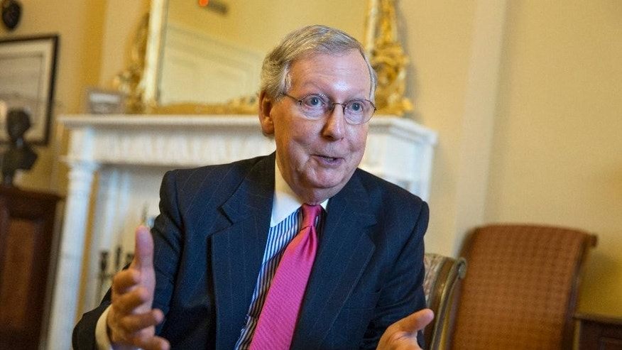 Senate Majority Leader Mitch McConnell of Ky. gestures during an interview with The Associated Press, Wednesday, Dec. 16, 2015, in his office on Capitol Hill in Washington. McConnell talked about the work to complete a compromise package that would fund the government through the 2016 budget year. McConnell also talked about the realities of divided government, working with new House Speaker Paul Ryan and his relationship with long-time Democratic nemesis Sen. Harry Reid of Nevada. (AP Photo/J. Scott Applewhite)