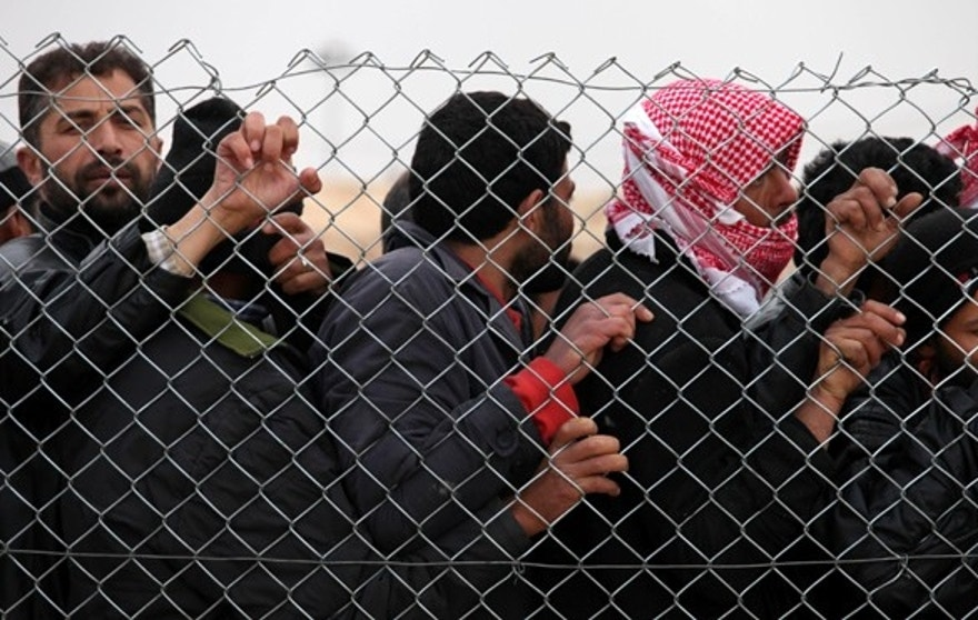 Syrian refugees wait for mattresses, blankets and other supplies, and to be assigned to tents at the Zaatari Syrian refugees camp in Mafraq, near the Syrian border with Jordan.