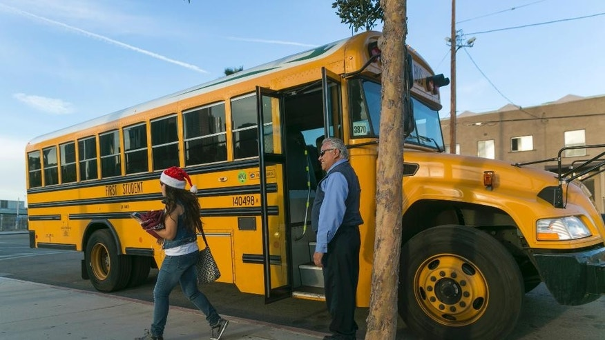 Los Angeles-area students arrive to school at the Edward R. Roybal Learning Center in Los Angeles Wednesday, Dec. 16, 2015. Students are heading back to class a day after an emailed threat triggered a shutdown of the vast Los Angeles Unified School District.  (AP Photo/Damian Dovarganes)