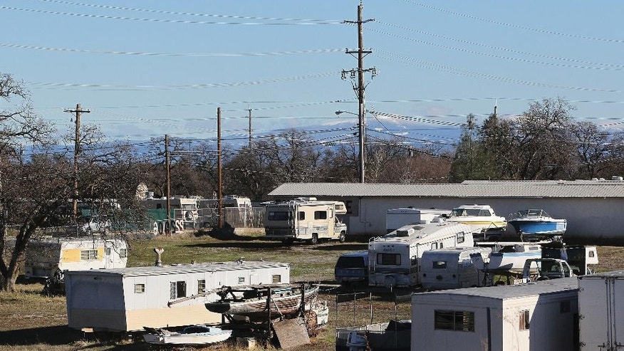 A commercial storage unit facility is shown Tuesday, Dec. 15, 2015, where two children were found dead in Redding, Calif. Autopsies were planned for the 3-year-old girl and 6-year-old boy, whose names were not released. No charges have been filed in their deaths. The investigation began with a call about a possible child abuse case in the small town of Quincy, about 220 miles northeast of San Francisco. (Andreas Fuhrmann/Record Searchlight via AP)